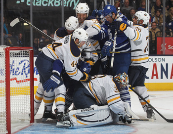 Hi-res-181766056-ryan-miller-of-the-buffalo-sabres-covers-up-the-puck-in_display_image