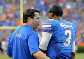 Coach Will Muschamp and QB Tyler Murphy