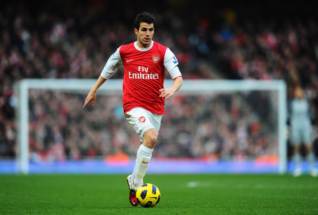 Hi-res-108249907-cesc-fabregas-of-arsenal-runs-with-the-ball-during-the_crop_650x440