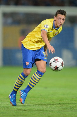 Hi-res-180966323-mesut-oezil-of-arsenal-in-action-during-the-uefa_display_image