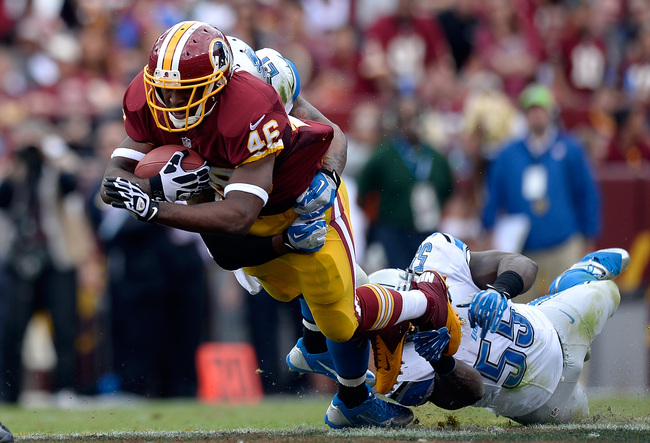 LANDOVER, MD - SEPTEMBER 22:  Alfred Morris #46 of the Washington Redskins is tackeld by Stephen Tulloch #55 of the Detroit Lions in the second quarter during a game at FedExField on September 22, 2013 in Landover, Maryland.  (Photo by Patrick McDermott/G
