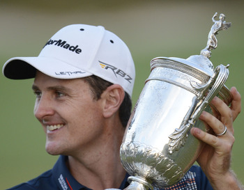 Justin Rose poses with the U.S. Open Trophy.