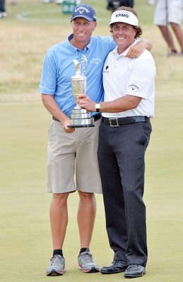 "Phil Mickelson and Jim ""Bones"" Mackay hold the Claret Jug."