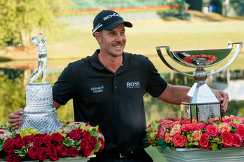Henrik Stenson with the Tour Championship trophy and the FedEx Cup.