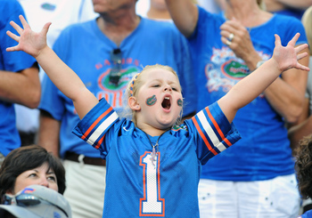Hi-res-181484009-young-fan-of-the-florida-gators-cheers-play-against-the_display_image