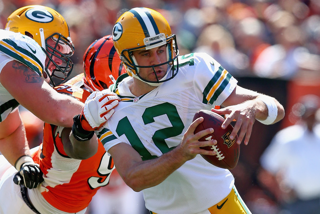 Hi-res-181580050-aaron-rodgers-of-the-green-bay-packers-runs-with-the_crop_650