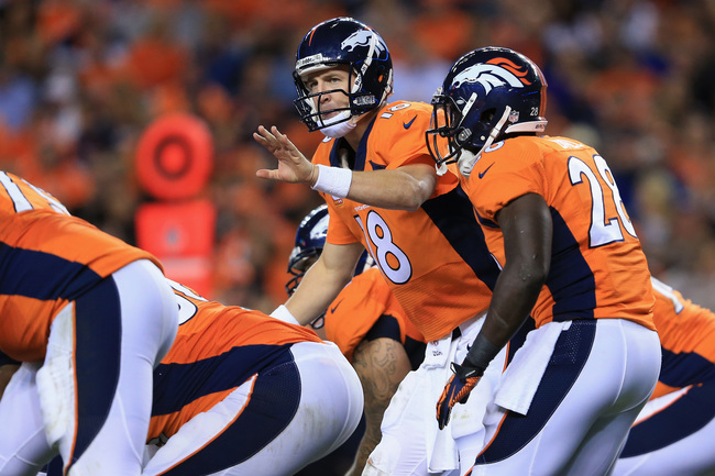 Hi-res-181711728-peyton-manning-of-the-denver-broncos-runs-the-offense_crop_650