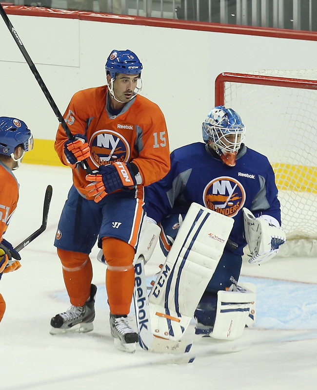 Hi-res-180383794-cal-clutterbuck-and-goaltender-kevin-poulin-of-the-new_crop_650