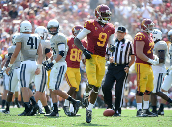 Hi-res-181477072-marqise-lee-of-the-usc-trojans-reacts-to-an-injury_display_image
