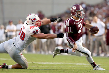 Hi-res-181493349-johnny-manziel-of-the-texas-a-m-aggies-rushes-past-zach_display_image