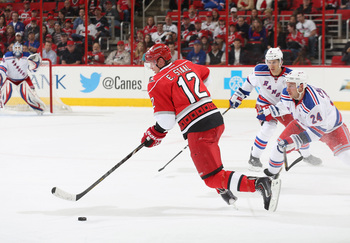 Hi-res-168323648-eric-staal-of-the-carolina-hurricanes-scoops-up-a-loose_display_image