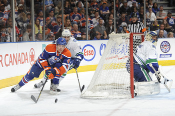 Hi-res-167693143-taylor-hall-of-the-edmonton-oilers-battles-for-the-puck_display_image