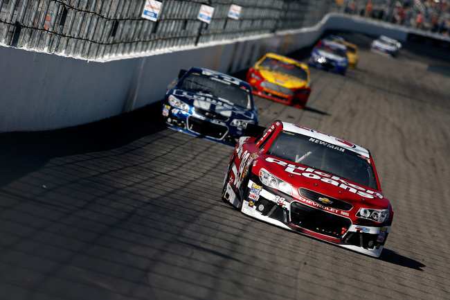 LOUDON, NH - SEPTEMBER 22:  Ryan Newman, driver of the #39 Quicken Loans Chevrolet, leads a group of cars during the NASCAR Sprint Cup Series Sylvania 300 at New Hampshire Motor Speedway on September 22, 2013 in Loudon, New Hampshire.  (Photo by Jeff Zele