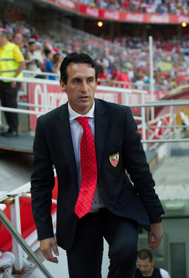 Hi-res-181804611-sevilla-fc-head-coach-unai-emery-takes-to-the-field-for_display_image
