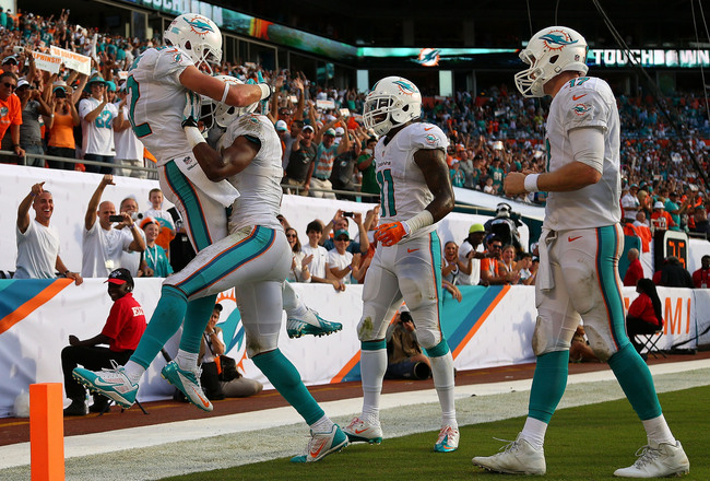 Hi-res-181594103-brian-hartline-of-the-miami-dolphins-reacts-to-scoring_crop_650x440