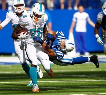 Hi-res-180645665-lamar-miller-of-the-miami-dolphins-runs-the-ball-as_display_image
