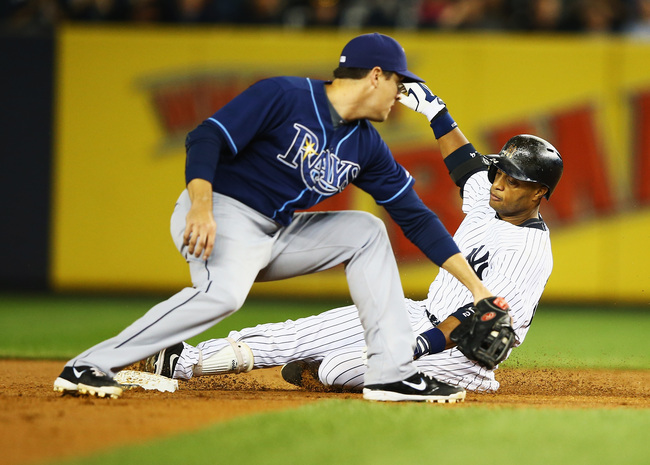 Hi-res-181814997-robinson-cano-of-the-new-york-yankees-drives-in-a-run_crop_650