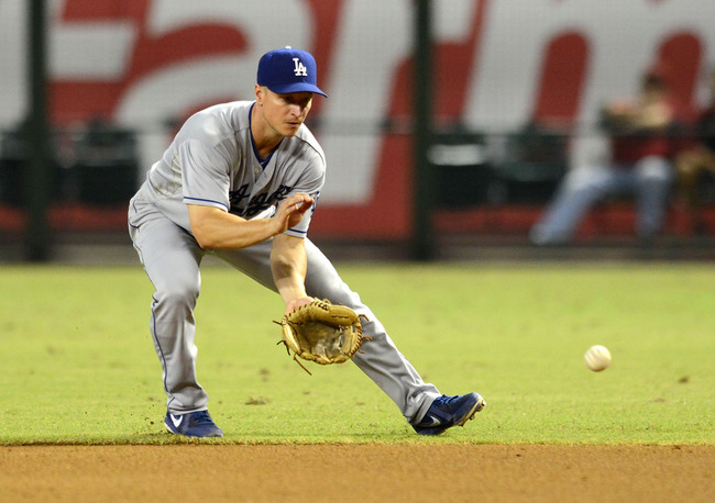 Hi-res-180924841-mark-ellis-of-the-los-angeles-dodgers-makes-a-play-on-a_crop_650
