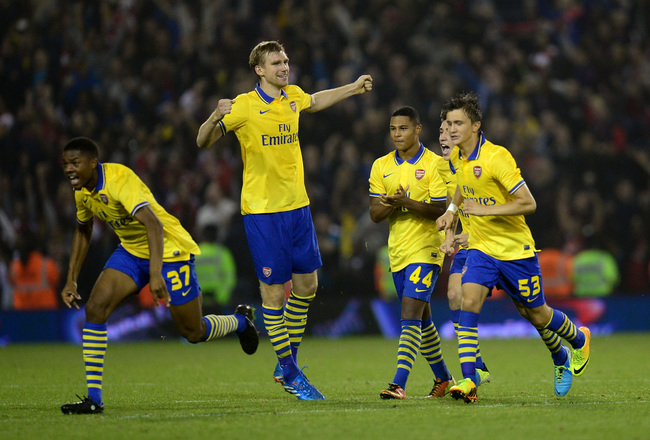 Hi-res-181809805-arsenal-players-celebrate-after-teammate-nacho-monreal_crop_650x440