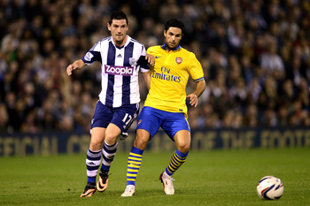 Hi-res-181801274-graham-dorrans-of-west-bromwich-albion-and-mikel-arteta_display_image