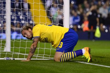 Hi-res-181801367-nicklas-bendtner-of-arsenal-goes-down-injured-during_display_image