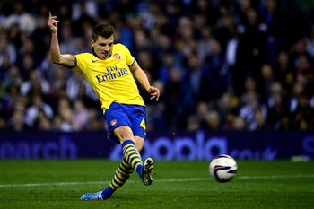 Hi-res-181804807-thomas-eisfeld-of-arsenal-scores-the-opening-goal_display_image