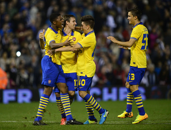 Hi-res-181809806-nacho-monreal-of-arsenal-is-congratulated-by-teammates_display_image