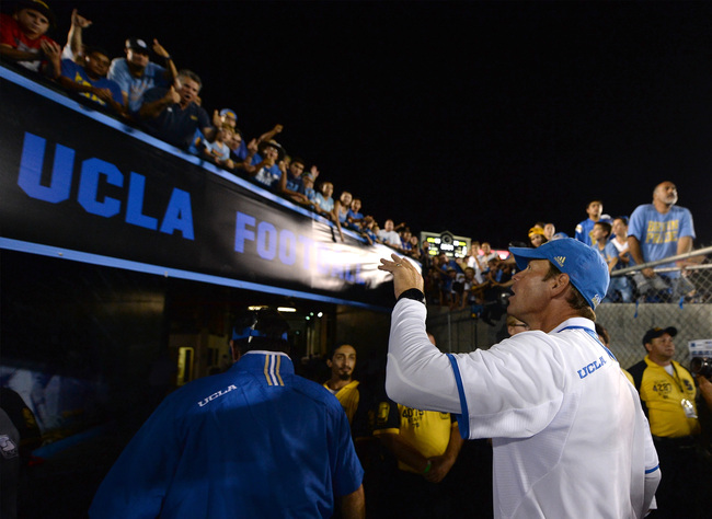 Hi-res-179394824-head-coach-jim-mora-of-the-ucla-bruins-waves-to-fans-as_crop_650