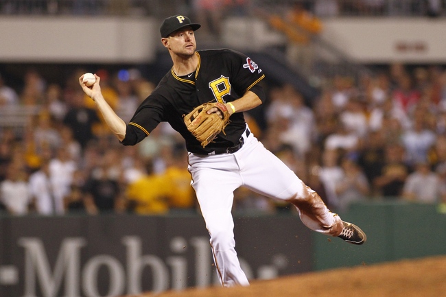 Hi-res-181382484-jordy-mercer-of-the-pittsburgh-pirates-makes-a-throwing_crop_650