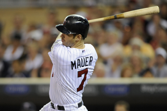 Hi-res-174043280-joe-mauer-of-the-minnesota-twins-hits-an-rbi-single_crop_650