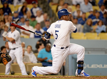 Hi-res-180175576-juan-uribe-of-the-los-angeles-dodgers-hits-a-solo_display_image