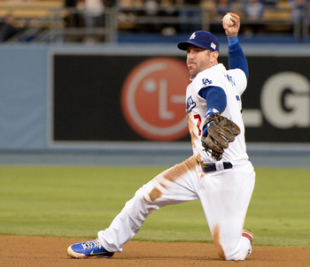 Hi-res-180347701-nick-punto-of-the-los-angeles-dodgers-throws-out-tuffy_display_image
