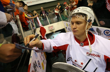Hi-res-180536638-mikhail-grabovski-of-the-washington-capitals-signs_display_image