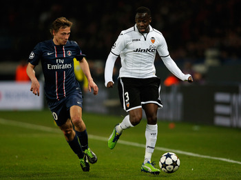 Hi-res-163222941-clement-chantome-of-psg-and-aly-cissokho-of-valencia_display_image