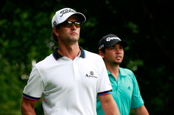 122071079-adam-scott-and-jason-day-look-on-from-the-tee-box-on_display_image