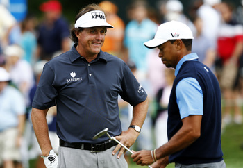 Hi-res-178663681-tiger-woods-and-phil-mickelson-of-the-usa-react-on-the_display_image