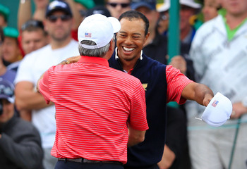Hi-res-133531454-tiger-woods-of-the-u-s-team-embraces-u-s-team-captain_display_image