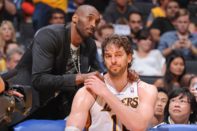 Hi-res-167735937-kobe-bryant-of-the-los-angeles-lakers-greets-teammate_crop_650