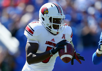 Hi-res-180554369-teddy-bridgewater-of-the-louisville-cardinals-runs-with_display_image