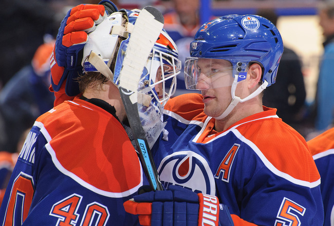 Hi-res-181714396-ladislav-smid-and-devan-dubnyk-of-the-edmonton-oilers_crop_650x440