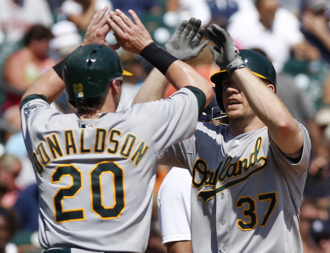 Hi-res-178339246-brandon-moss-of-the-oakland-athletics-gets-some-high_crop_650