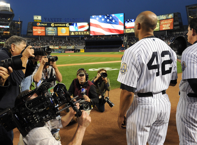 Hi-res-181814990-mariano-rivera-of-the-new-york-yankees-stands-during_crop_650