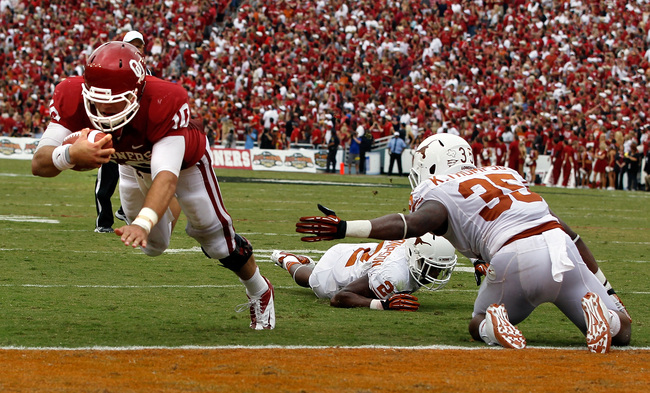 Hi-res-154064993-blake-bell-of-the-oklahoma-sooners-dives-into-the-end_crop_650