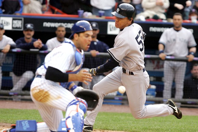 Hi-res-52966275-hideki-matsui-of-the-new-york-yankees-scores-from-first_crop_650