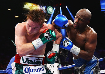 Hi-res-181785651-floyd-mayweather-jr-throws-a-right-to-canelo-alvarez_display_image