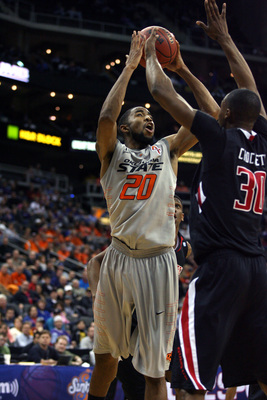 Hi-res-141249201-michael-cobbins-of-the-oklahoma-state-cowboys-shoots_display_image