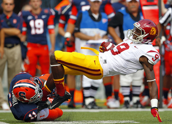 Hi-res-151586399-marqise-lee-of-the-usc-trojans-is-leg-tackled-by_display_image