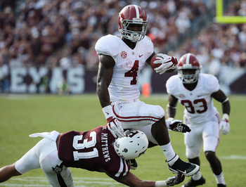 Hi-res-180581215-yeldon-of-the-alabama-crimson-tide-runs-against-howard_display_image