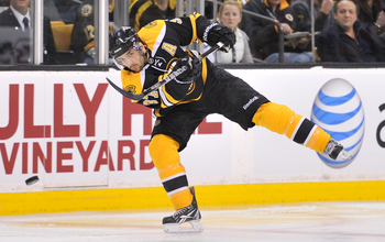 Hi-res-112212884-patrice-bergeron-of-the-boston-bruins-passes-the-puck_display_image
