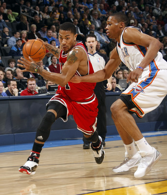Hi-res-96220462-derrick-rose-of-the-chicago-bulls-drives-toward-the_display_image